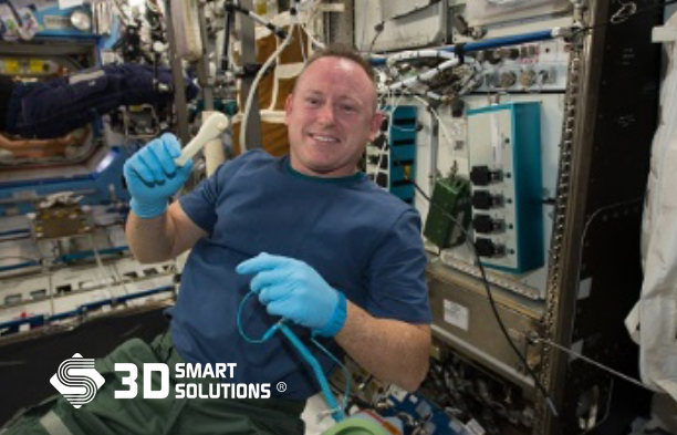 "International Space Station Expedition 42 Commander Barry ""Butch"" Wilmore shows off a ratchet wrench made with a 3-D printer on the station.(Source: NASA)"